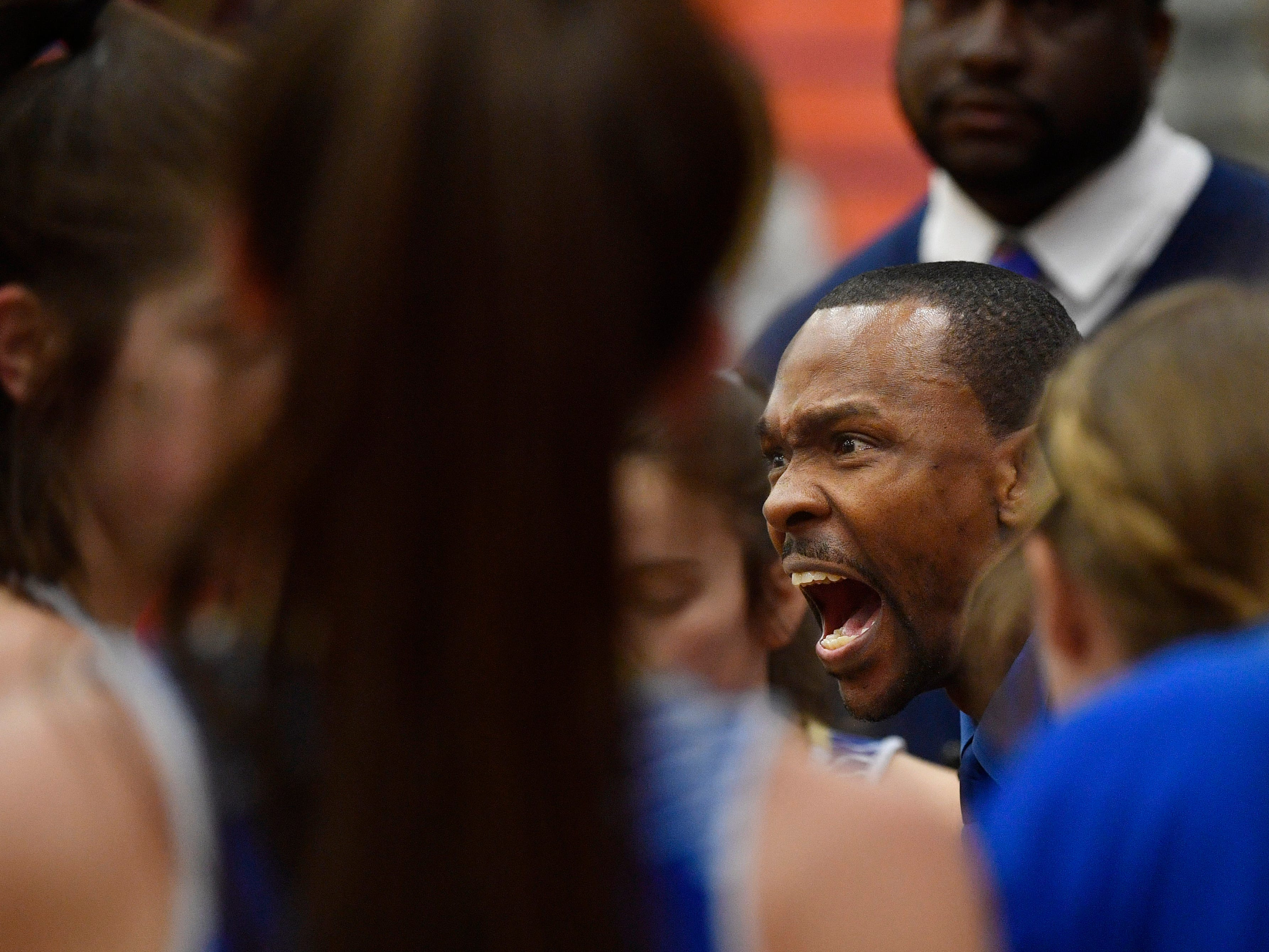 Brentwood coach Myles Thrash talks with his team during a break as Dickson plays Brentwood in the District 11-AAA girls basketball championship Monday, Feb. 18, 2019, in Dickson, Tenn.