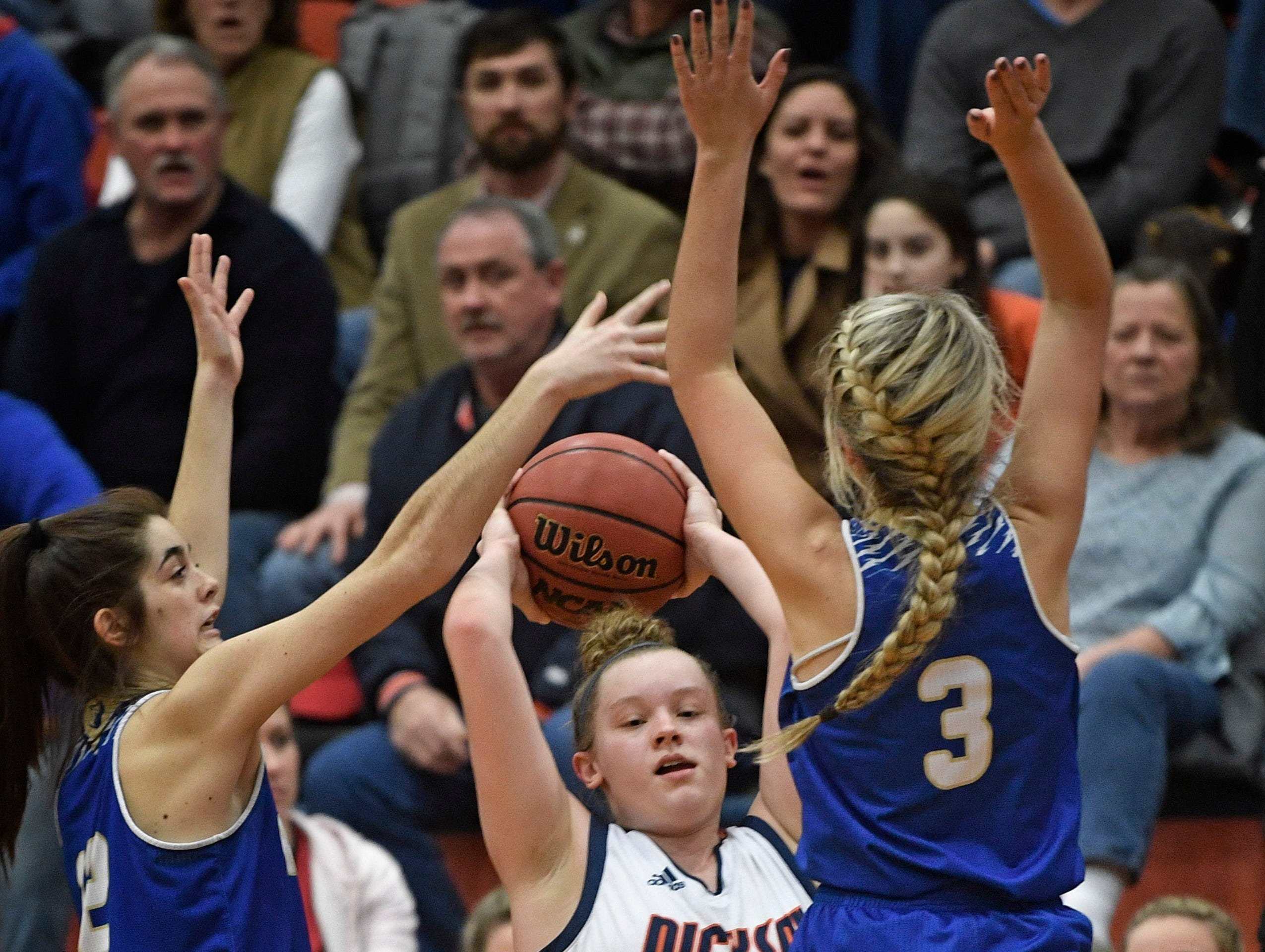 Olivia Rhinehart, 21, feels the pressure from defenders as Dickson plays Brentwood in the District 11-AAA girls basketball championship Monday, Feb. 18, 2019, in Dickson, Tenn.