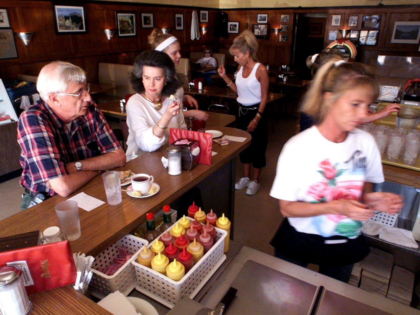 Wyatt Allen, left, 63 and Glenda Higgins, 64, both been faithful patrons for several years, enjoy their meal at Vandyland May 14, 2002.