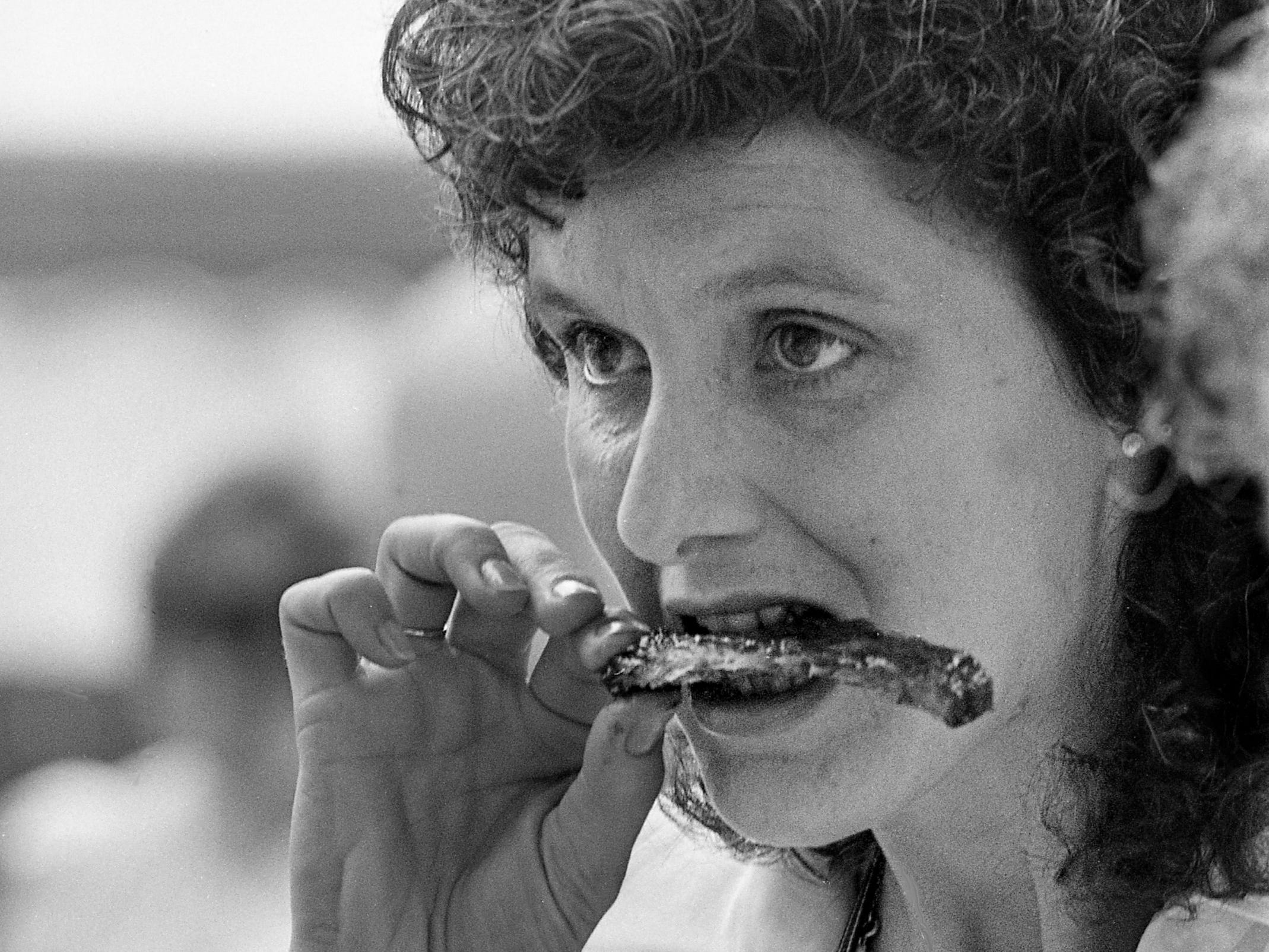 """Pat Weaver of Mt. Juliet is munching on a rib from Spats at Belle Meade Mansion for the """"Taste of Our Town"""" event Sept. 21, 1985."""