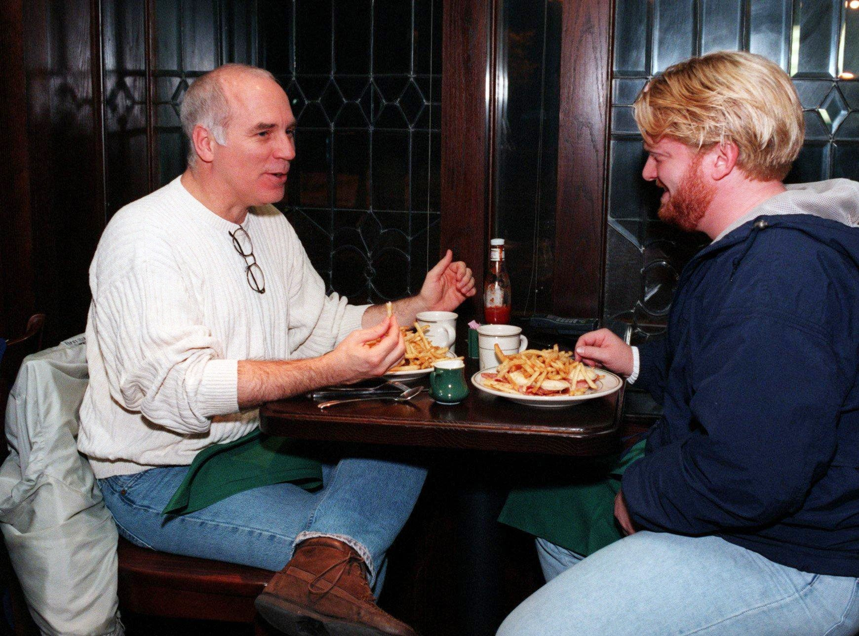 Danny Proctor, left, and Daryl Pike eat dinner at Ireland's restaurant Nov. 23, 1997.