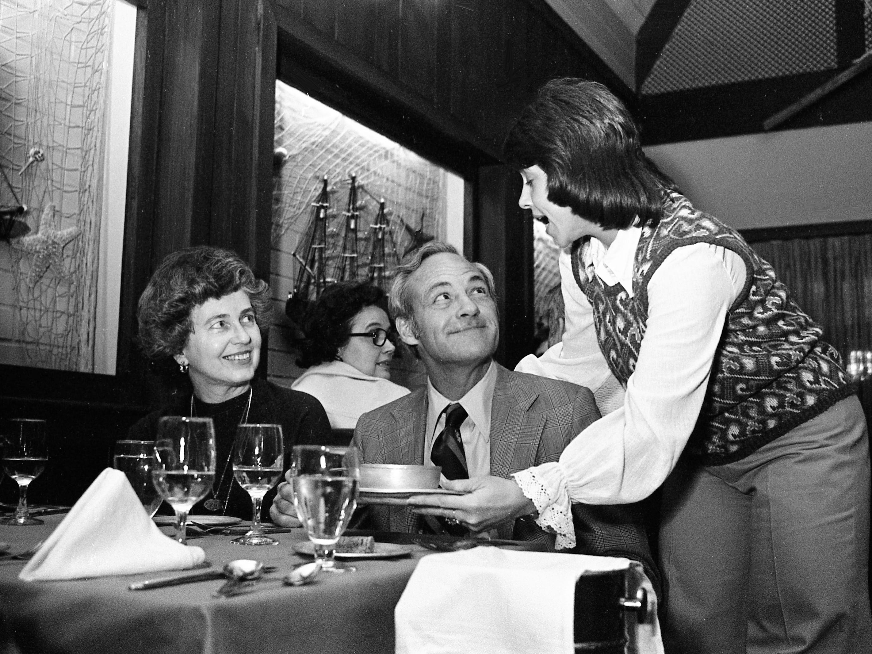 The chowder is served with a song at The Fisherman restaurant on West End Feb. 7, 1975. Waitress and co-manager Donna Ragan serves Mrs. and Mr. Mike Grace at the unique seafood establishment.