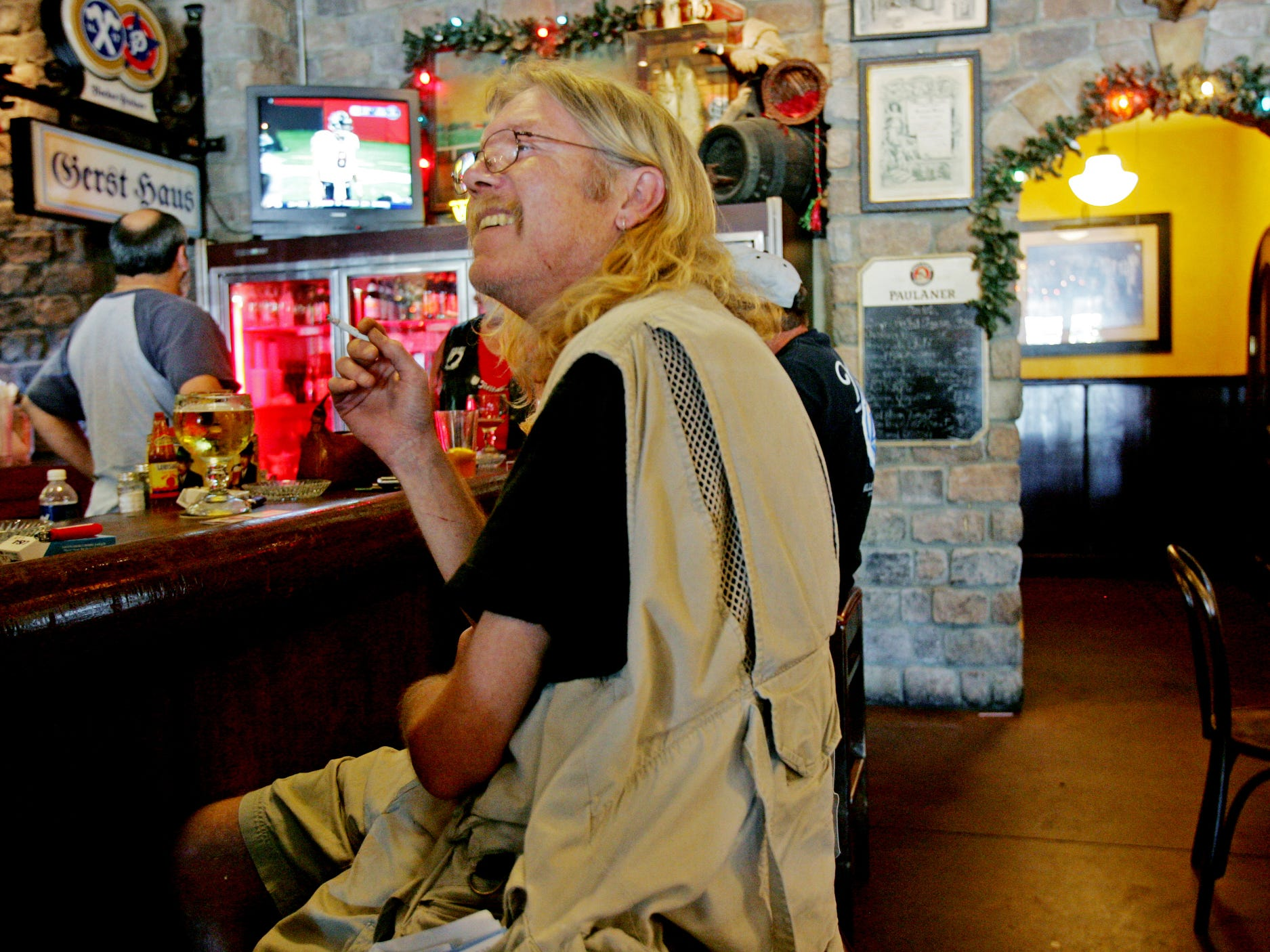 Patron Tim Lowery of Nashville enjoys a cigarette at the bar of the Gerst Haus Restaurant despite the smoking ban Sept. 30, 2007.