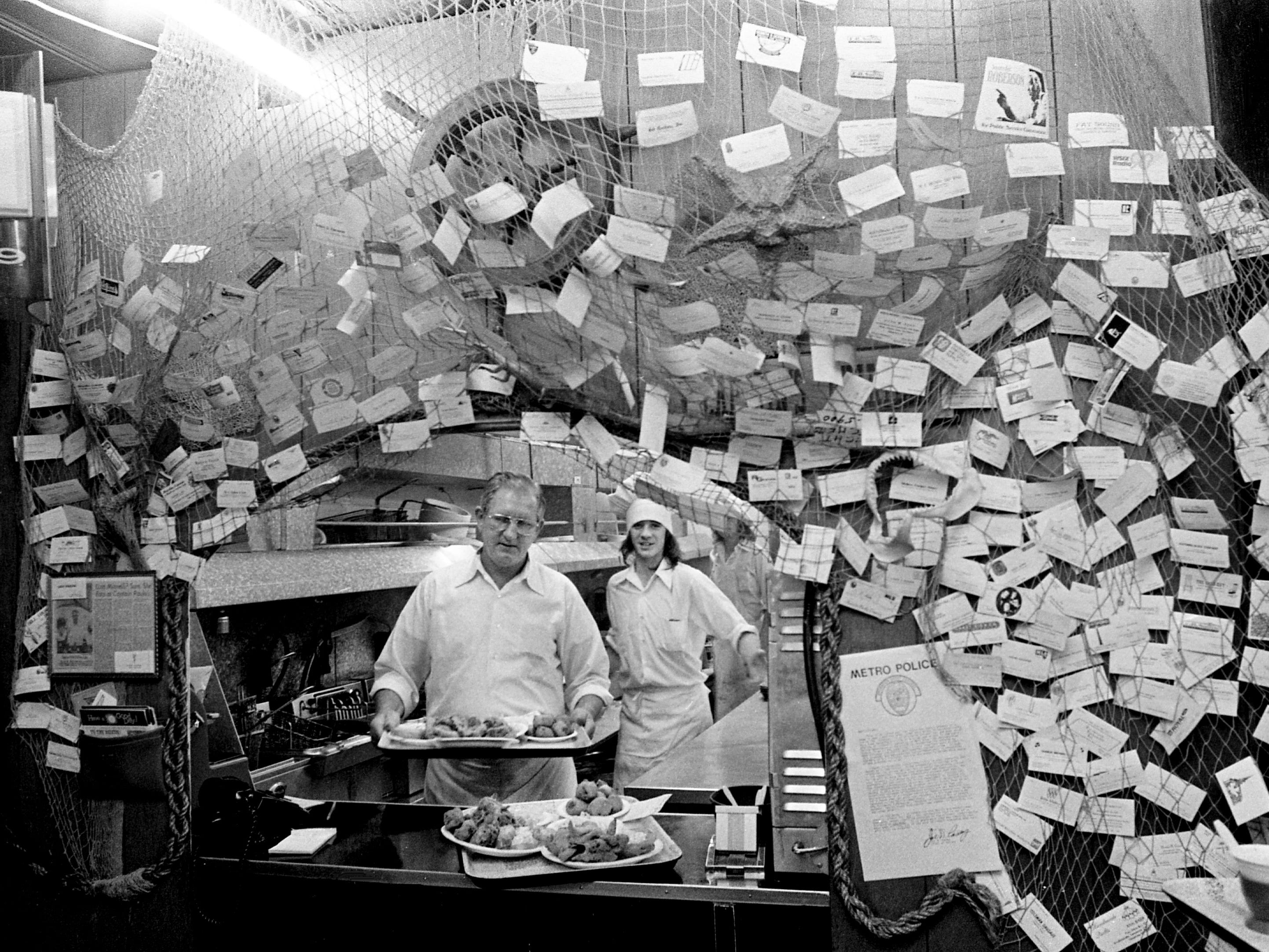 The Captain, Paul Vandenbergh, front, serves up seafood Jan. 16, 1975 at his Captain Paulo's restaurant tucked into a cluster of shops at the corner of Riverside Drive, east of the river off Gallatin Road. The restaurant squeezes up to 1,200 hungry, devoted customers into its three small rooms each day.