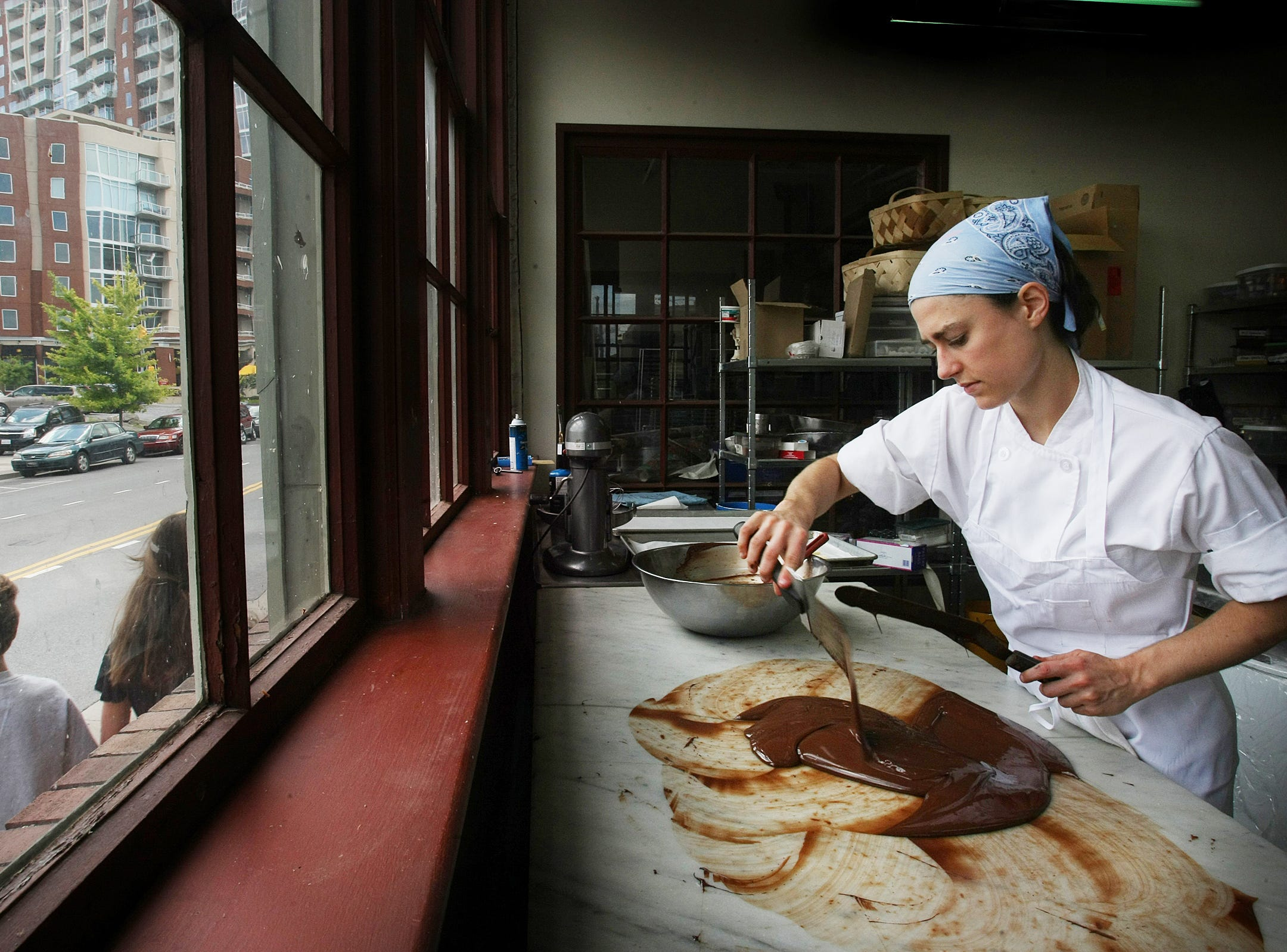 Pastry Chef Megan Williams works in the Provence bakery on the Gulch July 30, 2009.
