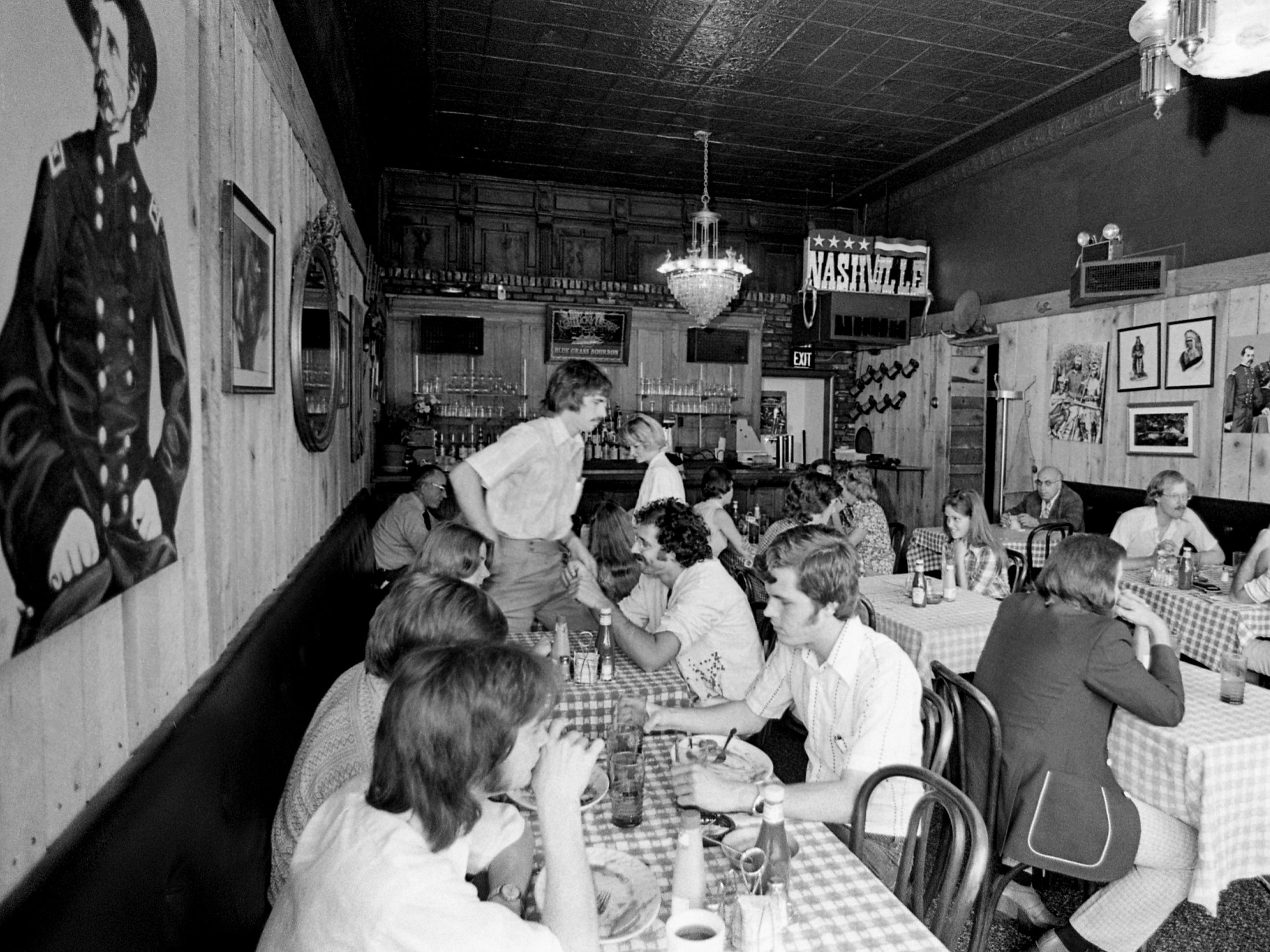 """Indian portraits, antique chandeliers and the familiar """"Nashville"""" sign from the Robert Altman film all blend in to give the Gold Rush here Sept. 9, 1976 a look straight out of the Old West. The Elliston Place establishment recently reopened its doors as an expanded restaurant."""