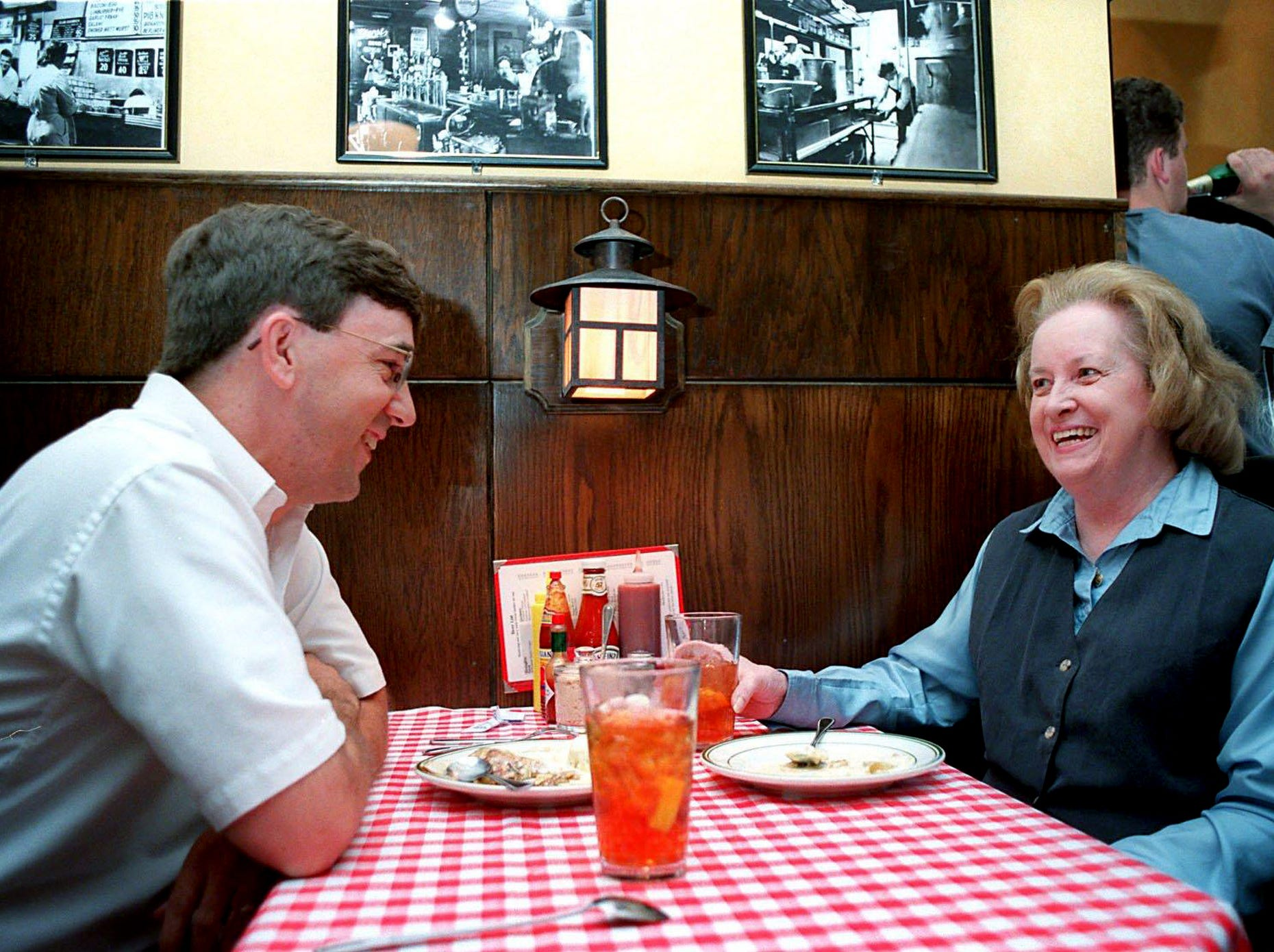 Terry Hundley and Audrey Brown talk over dessert as they enjoy their meal at the Gerst Haus Restaurant Aug. 18, 2000.