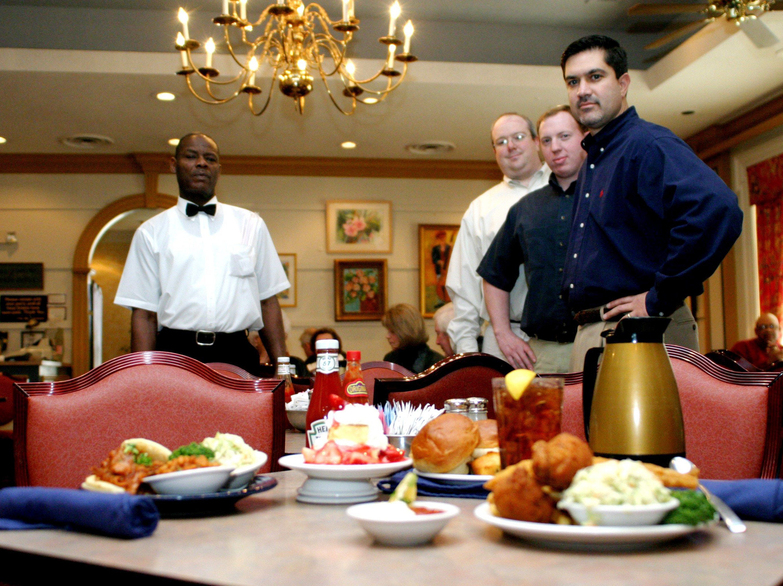 Robert Zirter, Corey Nix, Jeff Watson and owner Brian Glasser stand in The Belle Meade Cafeteria  Dec. 31, 2003 which is the city's oldest free standing restaurant.