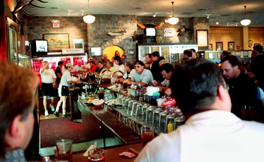The patrons packed the bar as they enjoy the Gerst Haus Restaurant Aug. 18, 2000.