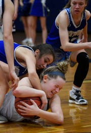Olivia Rhinehart tries to hold on to a loose ball as Dickson plays Brentwood in the District 11-AAA girls basketball championship Monday.