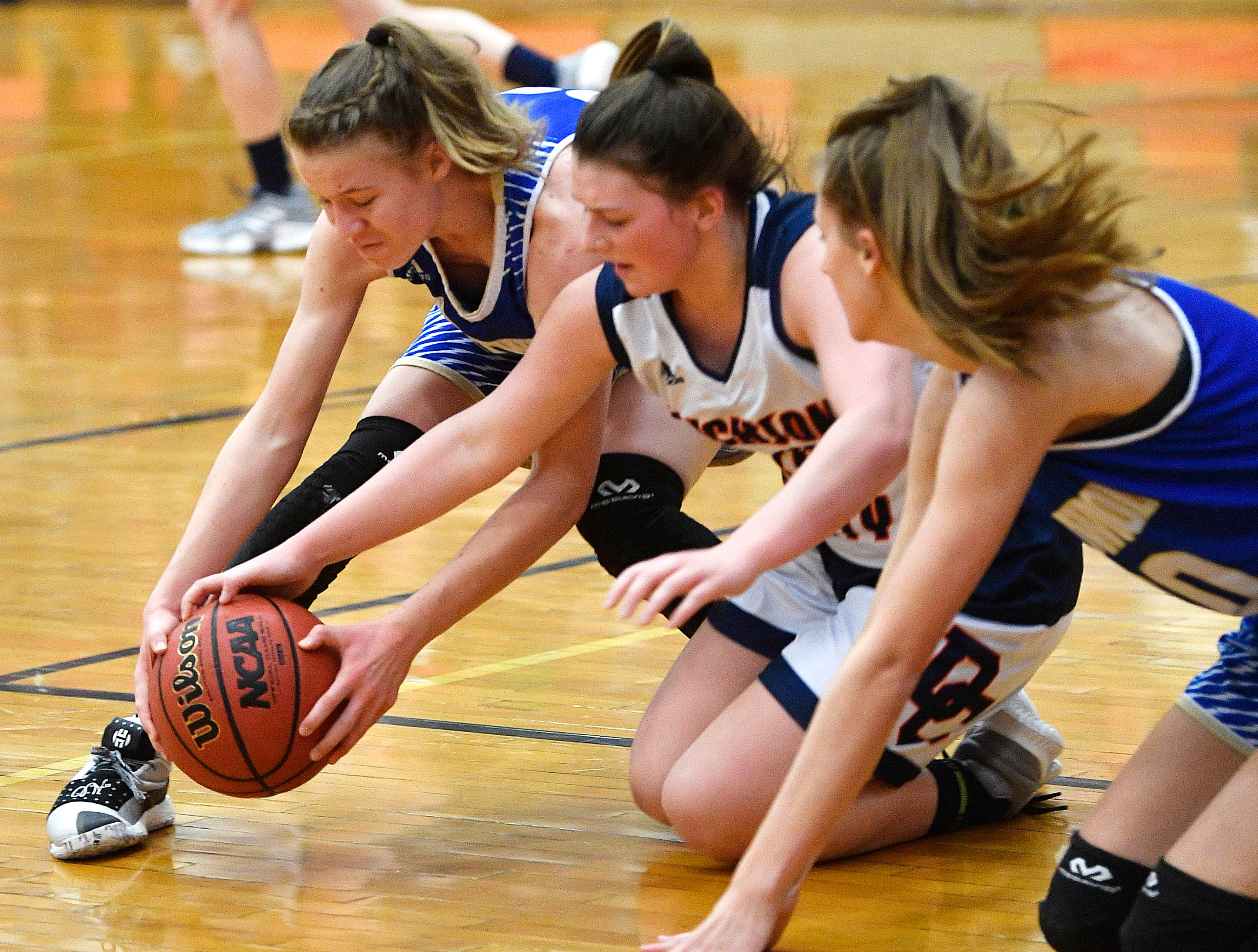 Amelia Osgood, 32, and KK Curtis, 20, fight for a loose ball as Dickson plays Brentwood in the District 11-AAA girls basketball championship Monday, Feb. 18, 2019, in Dickson, Tenn.