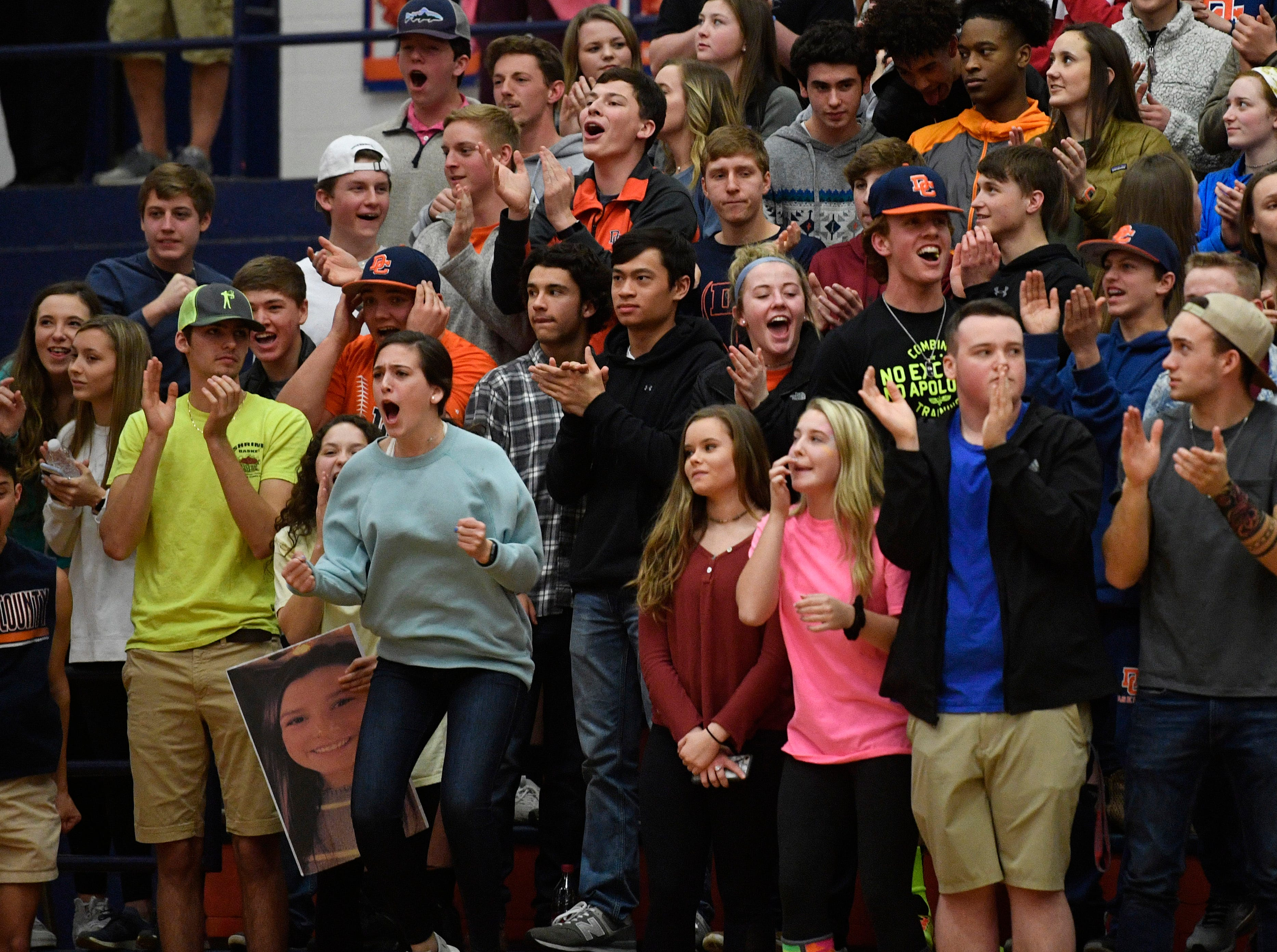 Dickson fans go wild as their teams comes from behind as Dickson plays Brentwood in the District 11-AAA girls basketball championship Monday, Feb. 18, 2019, in Dickson, Tenn.
