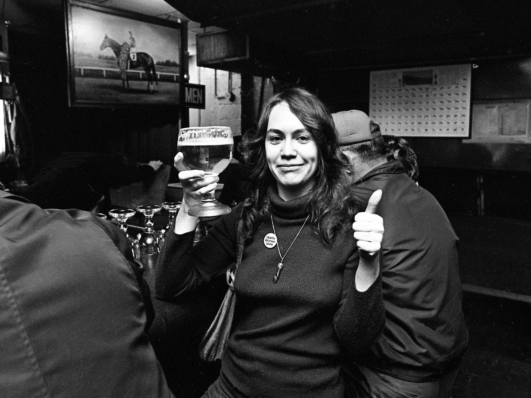 Linda Joyce Simpson gives the thumbs up sign as she hefts a mug of beer following an exercise in equal rights at the bar of the Gerst Haus Restaurant March 1, 1975. Angered by reports that the restaurant had refused to serve unescorted women at its bar, about a dozen women from Nashville Women's Center marched in at high noon to test the policy.