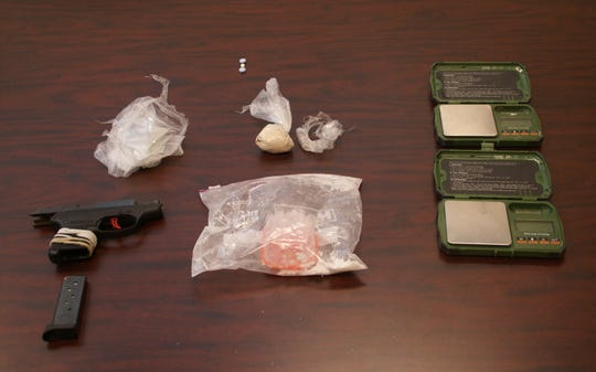 Drugs and drug paraphernalia, and a handgun found during the recent arrest of Charles Leach Jr.