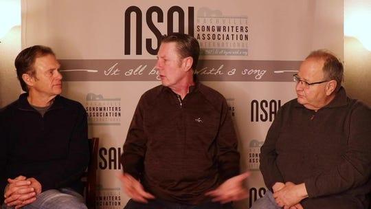 Tom Douglas, left, and Steve Seskin, right, talk with Bart Herbison.