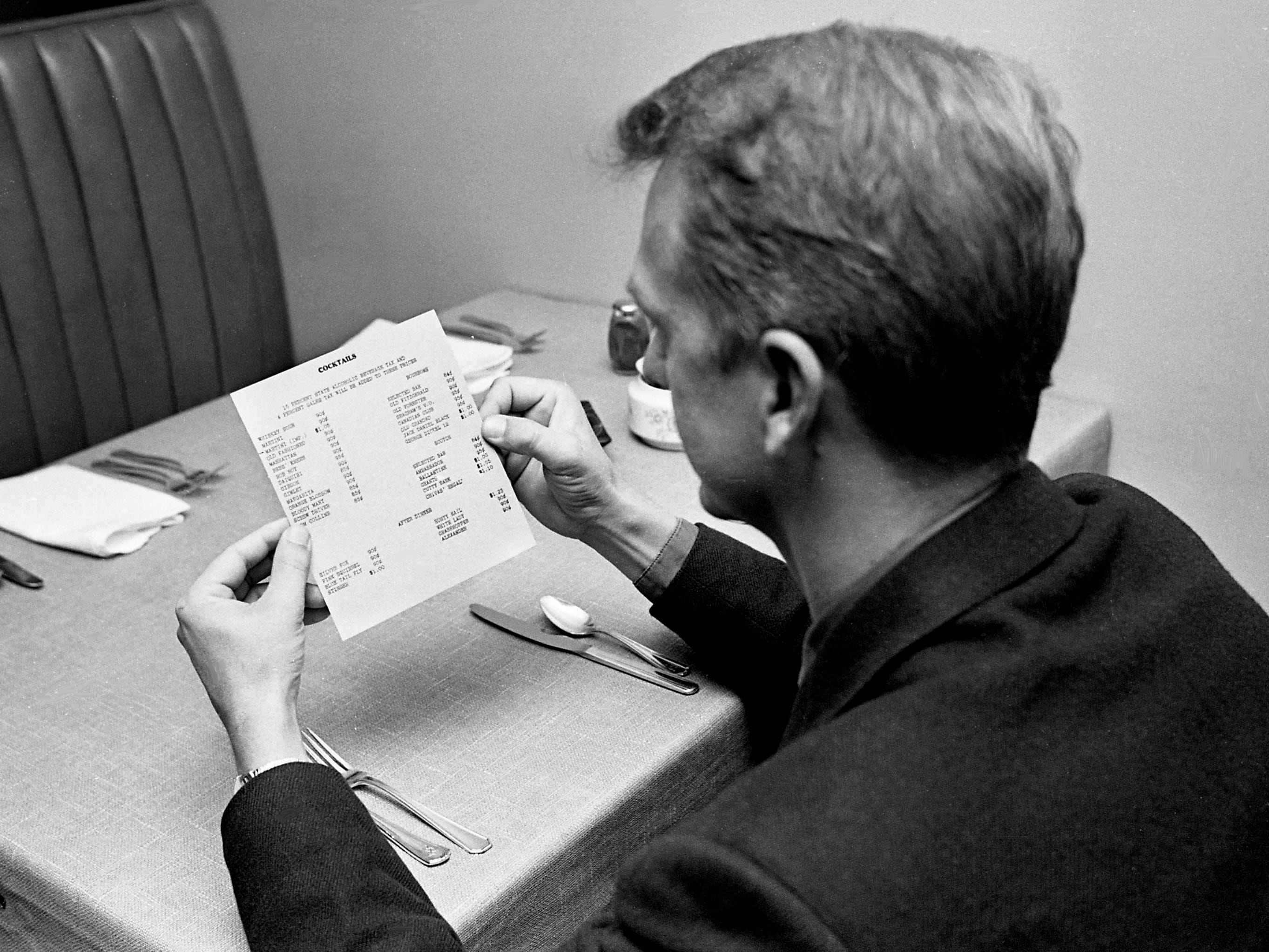 Don Dickerson, 32, the first Nashvillian to buy a mixed drink here legally, carefully inspects a cocktail menu at the Cross Keys Restaurant Nov. 16, 1967. The state Alcoholic Beverage Commission approved licenses for five applicants in the Nashville area recently.