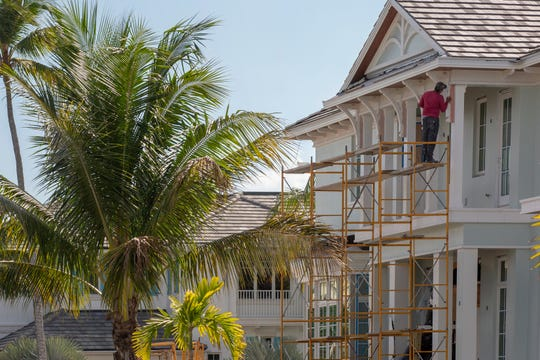 Work continues on a home Tuesday, Feb. 19, 2019, in Naples.