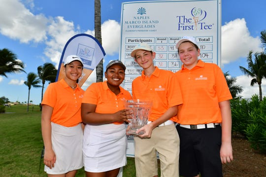 The First Tee of The Triangle's Catherine Vivongsy and Tyla McAffity, both 15, and The First Tee of Greater Chicago's Ryan Myer and Brendan Cleary, also both 15, pose with the trophy after tying for the Golf to Paradise-First Tee Champions Challenge on Sunday, Feb. 17, 2019, at Lely Resort's Flamingo Island Course. The two chapters beat 10 other chapters in three different formats over three days. The first two rounds were played at Quail Creek Country Club.