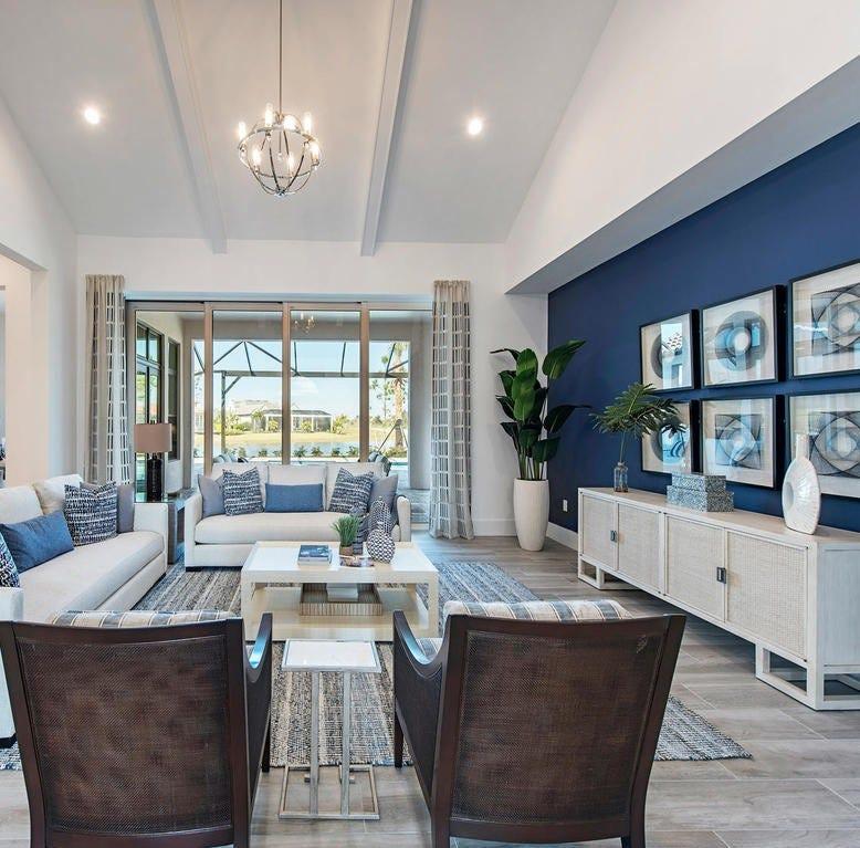 Clive Daniel Home installs furnishings in models at Ashton Woods