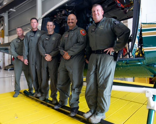 Sean Arthur, from left, Josh White, Matthew Mecera, Jeffrey Colon and Dennis DeRienzo at the CCSO Special Operations unit on Tuesday, Feb. 19, 2019. The crew responded to a call Monday night when a 67-year-old man fell off a swamp buggy and hit his head at Big Cypress National Preserve about 8 miles south of mile marker 63.
