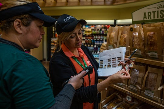 Ennys Ortiz and Celina Judson prepare for the Sprouts Farmers Market's Wednesday opening in North Naples on Tuesday, Feb. 19, 2019.
