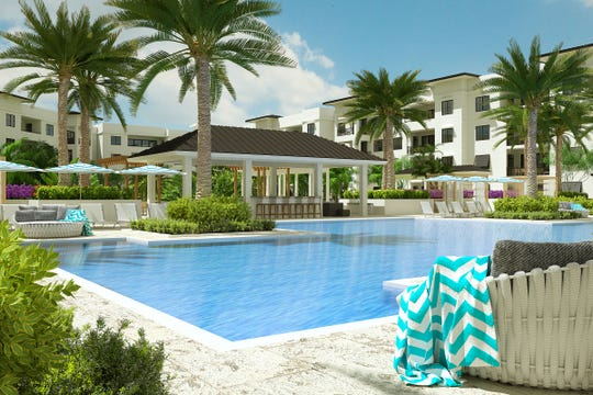 Resort-style pool with a beach entry and two 90-foot lap lanes at Eleven Eleven Central.