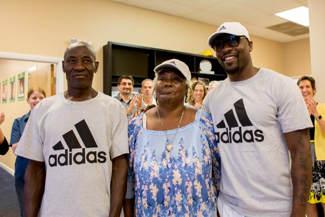 Immokalee native Mackensie Alexander (right), now a cornerback with the NFL's Minnesota Vikings, stands with parents Jean and Marie at the Habitat for Humanity of Collier County office in Naples. Alexander paid off the mortgage of his parents' Habitat home in Immokalee on Friday, Feb. 15, 2019.