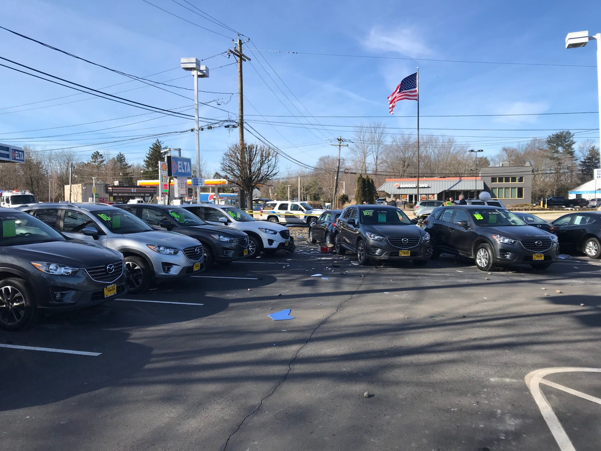 Several cars at Wayne Mazda were damaged by flying debris after a serious collision on Route 23.