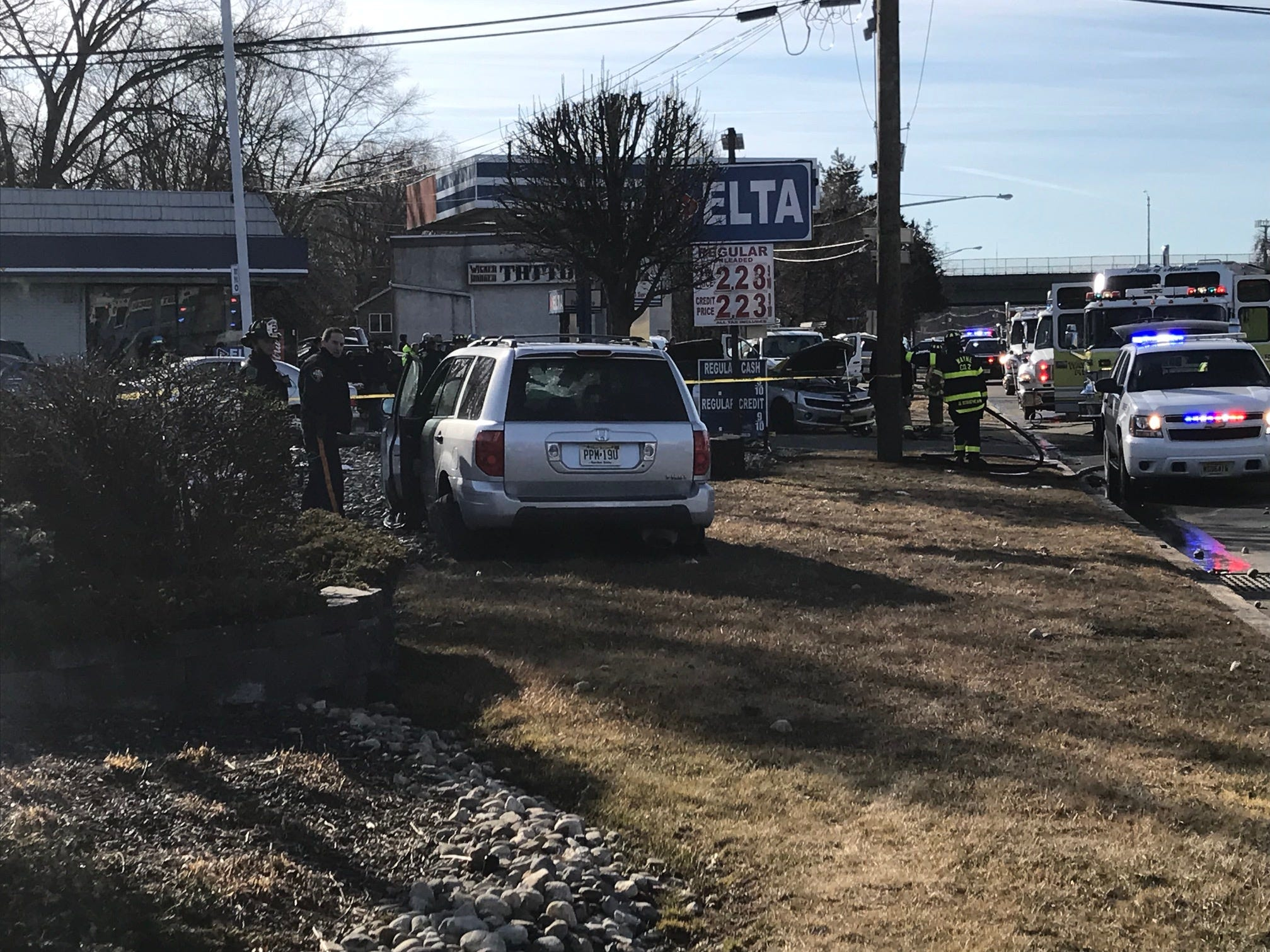 Police observe one of the vehicles involved in a serious car crash at the Delta Gas Station on Route 23 in Wayne.