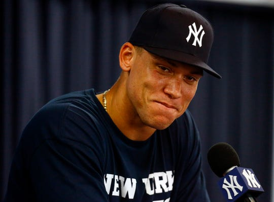 New York Yankees right fielder Aaron Judge (99) speaks to the media during spring training at George M. Steinbrenner Field.