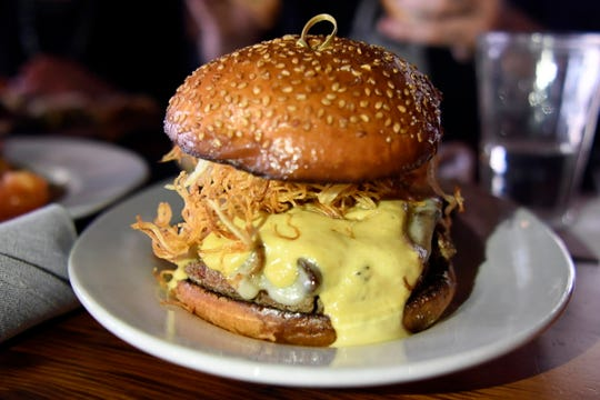 """""""The Impossible Burger"""" at The Barrow House in Clifton, NJ. The """"burger"""" is vegetarian, made with smoked portabella mushrooms, carmelized onions, havarti cheese, shoestring potato crisps, chive aoili, and horseradish dijonaise."""