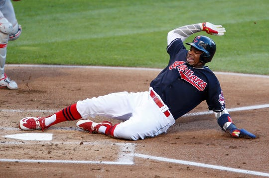 Cleveland Indians' Rajai Davis scores on a pass ball by Washington Nationals catcher Wilson Ramos during the first inning of a baseball game Tuesday, July 26, 2016, in Cleveland.