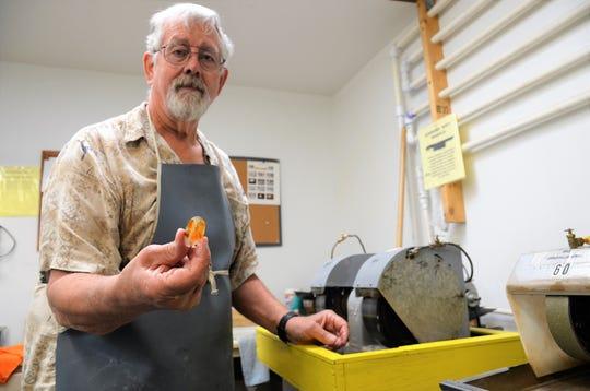 Deming Gem and Mineral Society member Steve Sunstrom shows of freshly polished cabochon gemstone.
