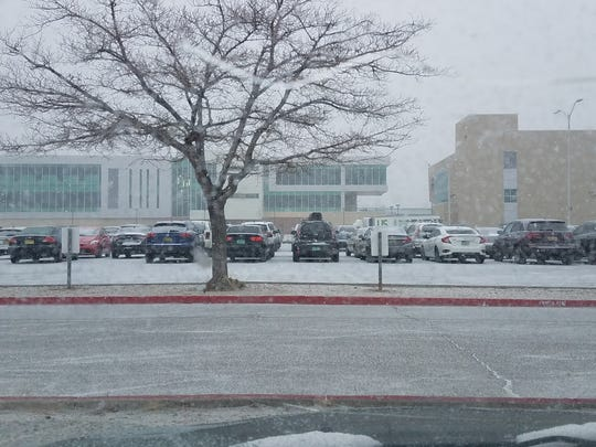 Snow falls about 8 a.m. Tuesday, Feb. 19, 2019 on the campus of the University of New Mexico in Albuquerque.