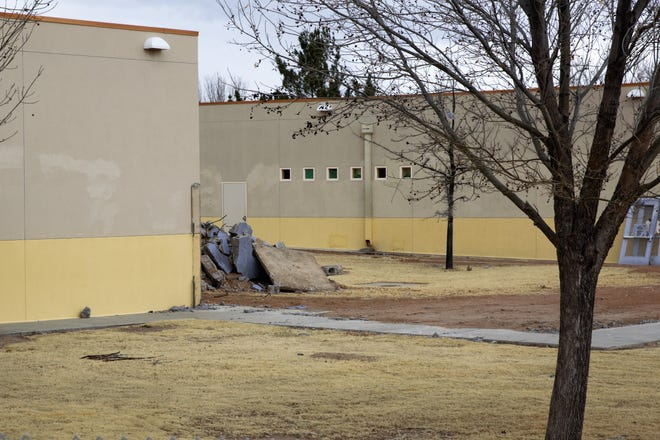 Material removed from an exterior wall at Columbia Elementary School remained piled up behind the school on Feb. 19, 2019.