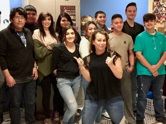 Victoria Apodaca-Fisk, a high school teacher at New America School-Las Cruces, (pictured above center with her students) has been selected for the 2019 Teach Plus New Mexico Teaching Policy Fellowship program.