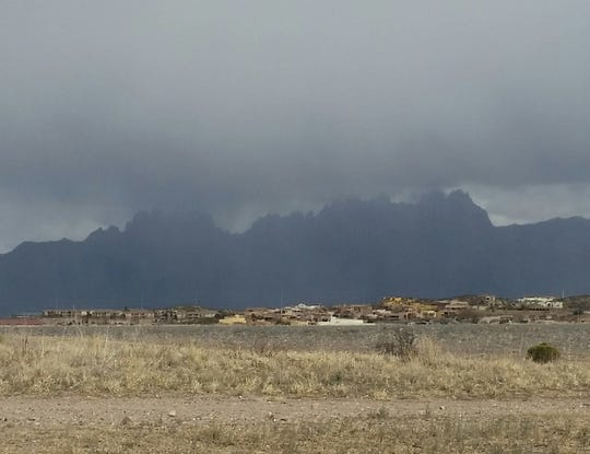 Amid a day of off-and-on snow flurries, clouds obscure the Organ Mountains the afternoon of Tuesday, Feb. 19, 2019 in Las Cruces.