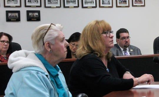 Stephanie Du Bois, left, and Alamogordo City Commissioner Nadia Sikes, right, address the Otero County Commission at the Otero County Commission meeting on Feb. 14.