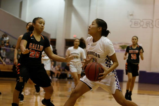 Kirtland Central's Melanie Yazzie drives toward the basket against Gallup's Kamryn Yazzie during a District 1-4A game Friday, Feb. 8 at Bronco Arena. KC is now No. 1 in the lates 4A girls basketball rankings.
