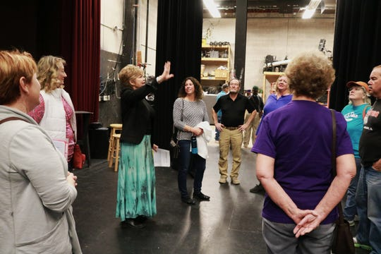 Flickinger Center Board member Teresa Ham points out some of the features of the stage area during the Behind the Scenes Tour with the Alamogordo Adventures Meetup group.