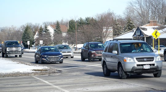 Traffic moves along Ann Arbor Road west of Newburgh on Feb 19.