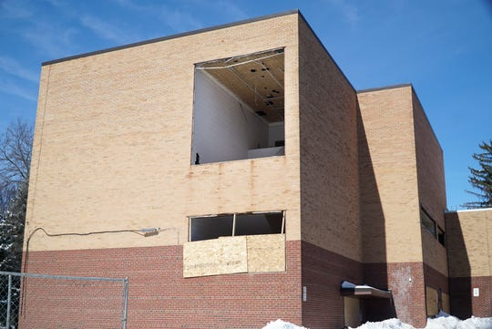 Tear-down of Northville's Main Street School has begun. On Feb. 19 a gaping opening on its south side shows that some of the building's interior has begun to fall to demolition.