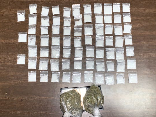 Police seized marijuana, and powdered cocaine divided into baggies from a vehicle in Opelousas Monday.