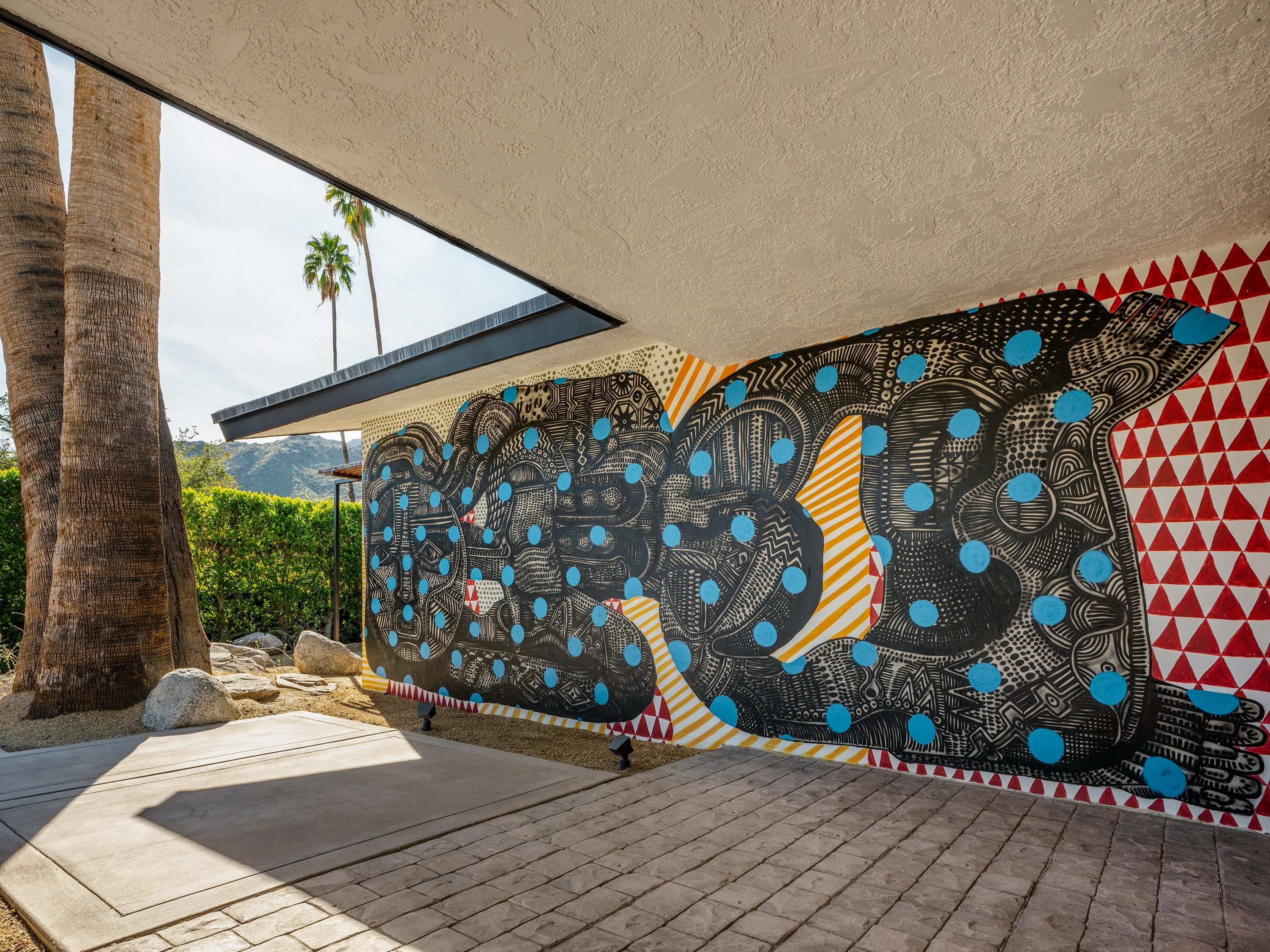 Zio Ziegler completed the murals at this Palm Springs ranch-style property owned by Tod Mostero.