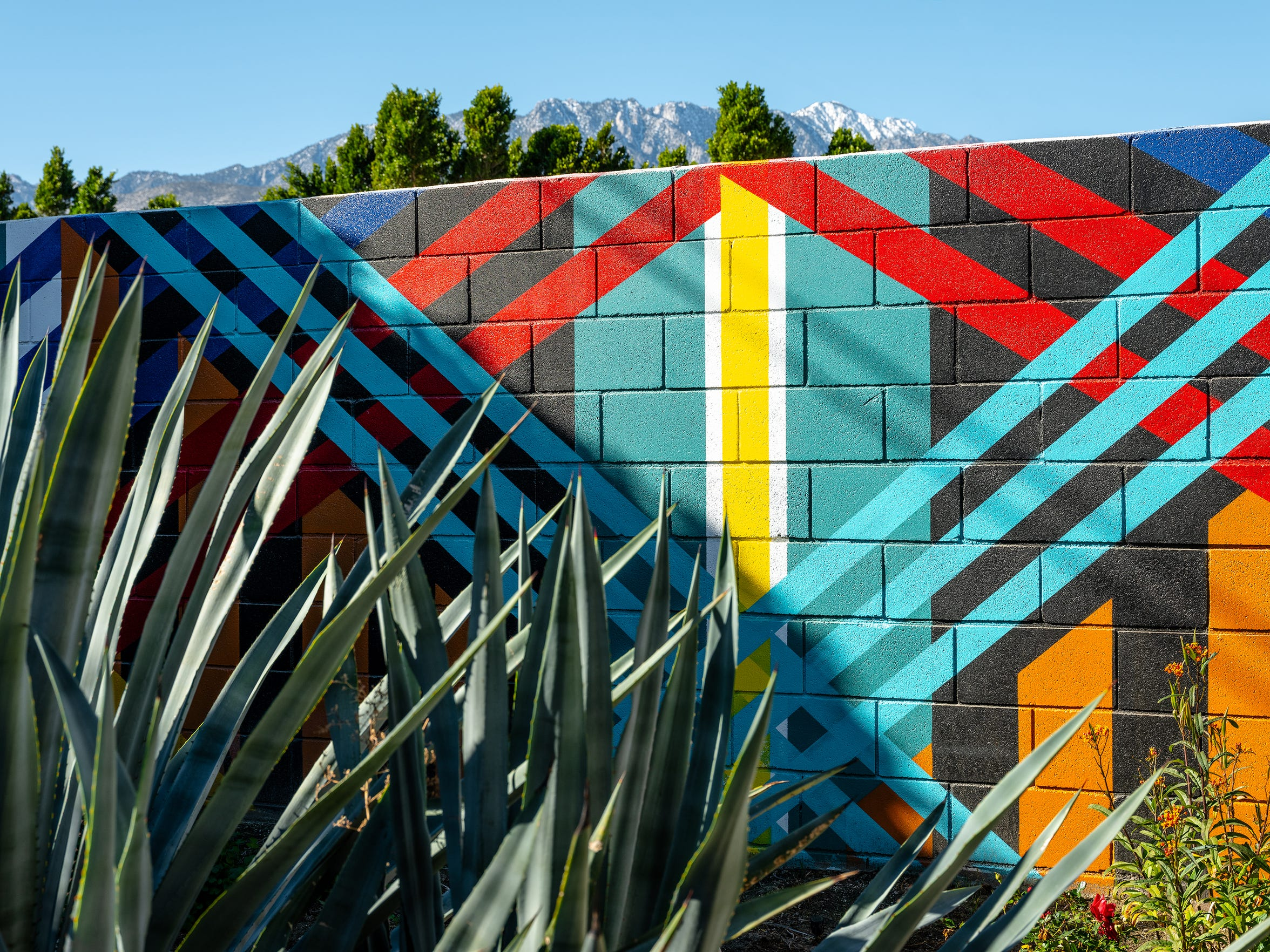 Ryan Campbell completed the mural featured on a back wall at Sanctuary Palm Springs.