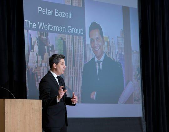 Peter Bazeli, the principal and managing director of Weitzman Associates LLC, speaks Monday during CivicCon at the Sanders Beach-Corinne Jones Resource Center in Pensacola.