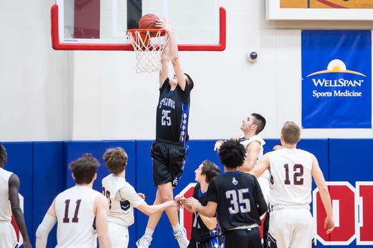 Garden Spot's Andrew Zentner dunks the ball during play against New Oxford in the first round of the District III Class 5A playoffs Monday, February 18, 2019. The Colonials fell 41-39.