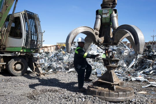 Marcos Santiago readies his crane to sort scrap, February 12, 2019, at Consolidated Resources Inc., 4849 W. Missouri Ave., Glendale.