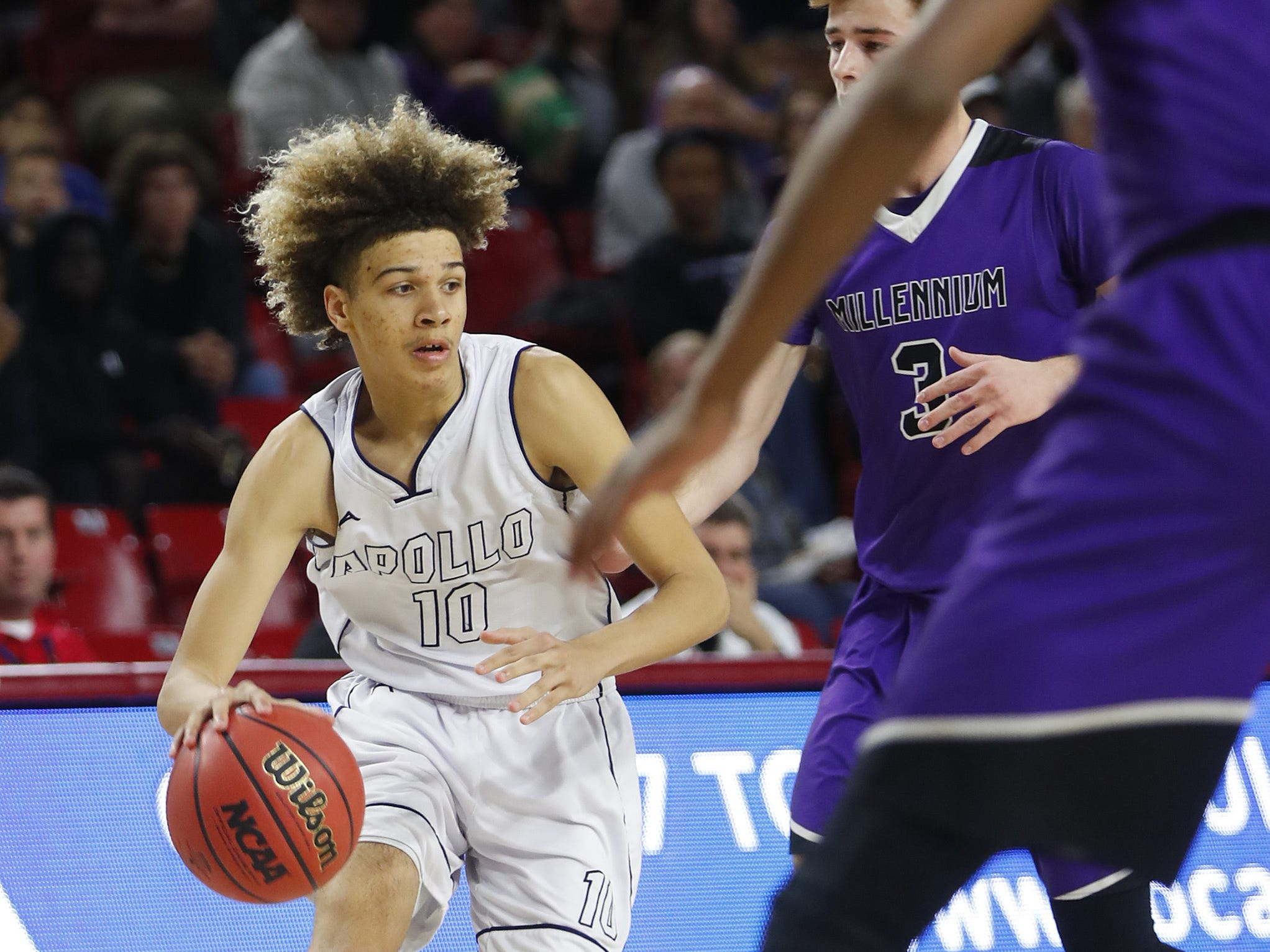 Apollo's Paris Woods (10) drives on Millennium's Michael Batchelor (3) during the 5A boys basketball state semifinal game at Wells Fargo Arena in Tempe, Ariz. on February 18, 2019.
