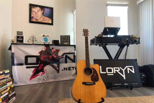 The live stage area featuring equipment and paraphernalia with Drexler'selectronica artist name, Loryn.